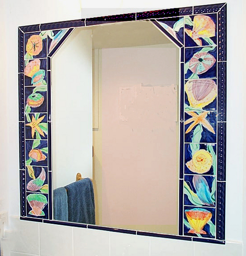 Inset mirror of majolica tiles