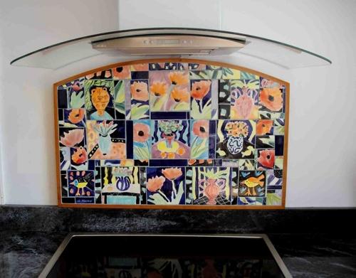 Custom designed majolica tile mosaic backsplash