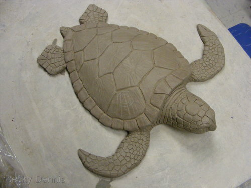 Greenware turtle sculpture.