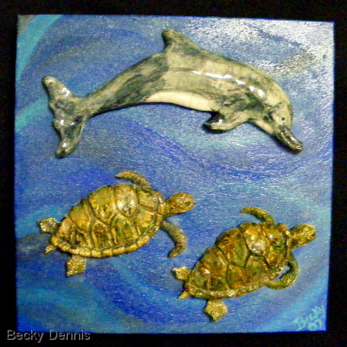Dolphin swims with Turtles