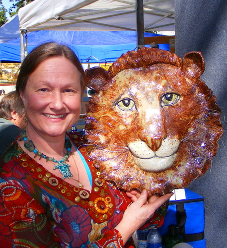Becky Dennis with Lion head sculpture