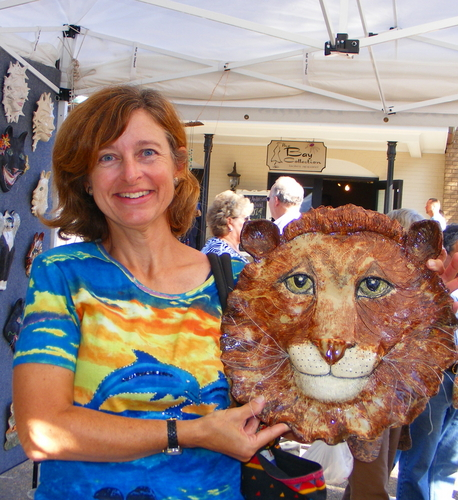 Customer with Lion head sculpture