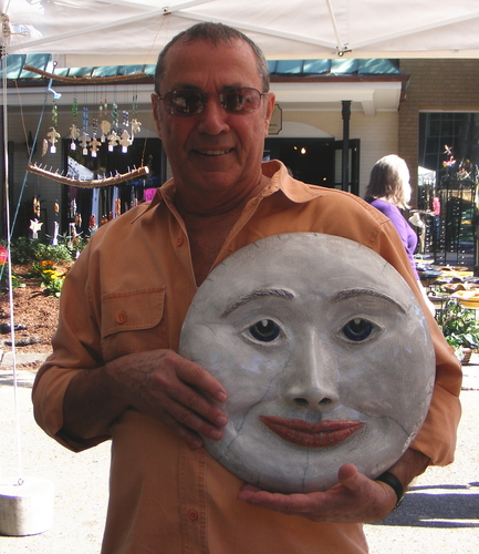 Customer with raku Moon sculpture