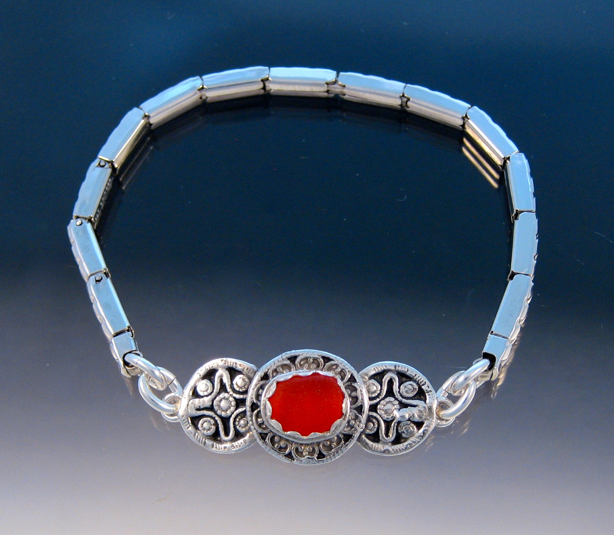 *****ON HOLD FOR JUDY*****B230 - Orangey/red in triple vintage button stretch bracelet (large view)