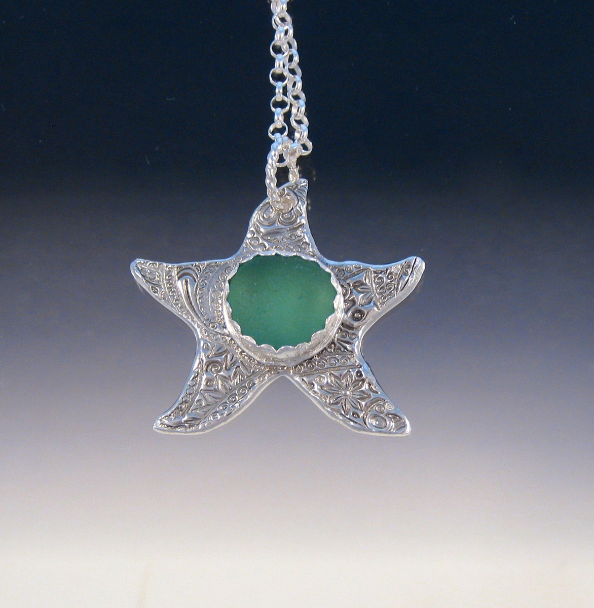 P5046 - Starfish with mossy green sea glass (large view)