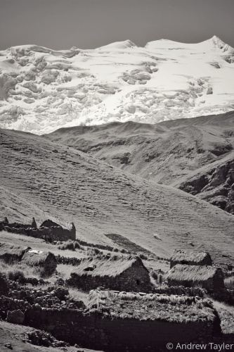 A stone and thatch village high in the Andes Mountains