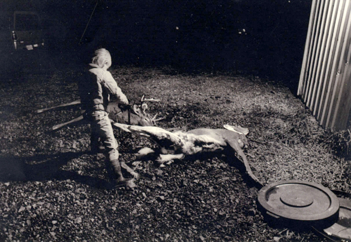 Boy Sawing On Dead Deer, Big Pool, MD (large view)