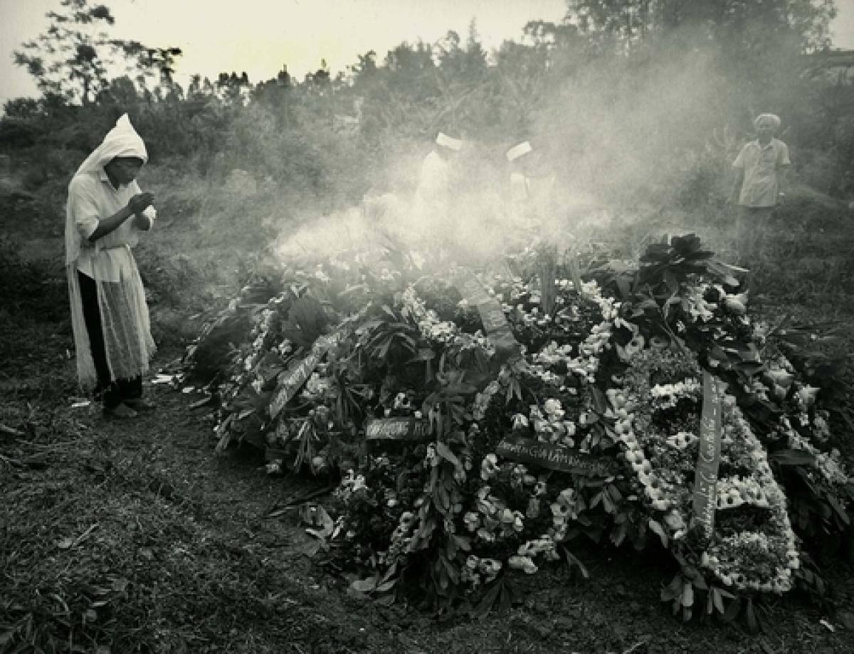 Woman Praying At Grave, Hanoi, Vietnam, 1990 (large view)