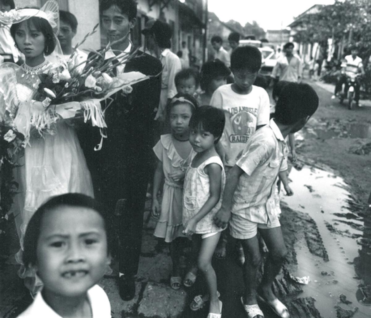 Bride, Groom and Children, Street inHanoi, Vietnam, 1990 (large view)