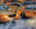 evening NYC street scene with taxi cabs (thumbnail)