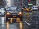 Sixth Avenue, NYC, in rain with limos and taxis (thumbnail)