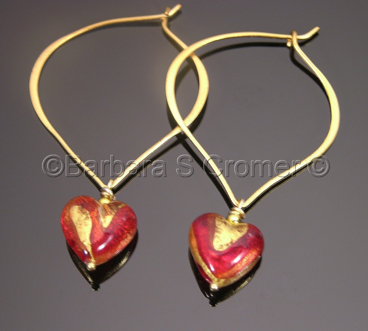 heart earrings of Red Venetian lamp work, embedded 24 Kt. gold,  splashes of  24 Kt gold with gold filled trim,  large handmade Vermeil lotus ear wire (large view)