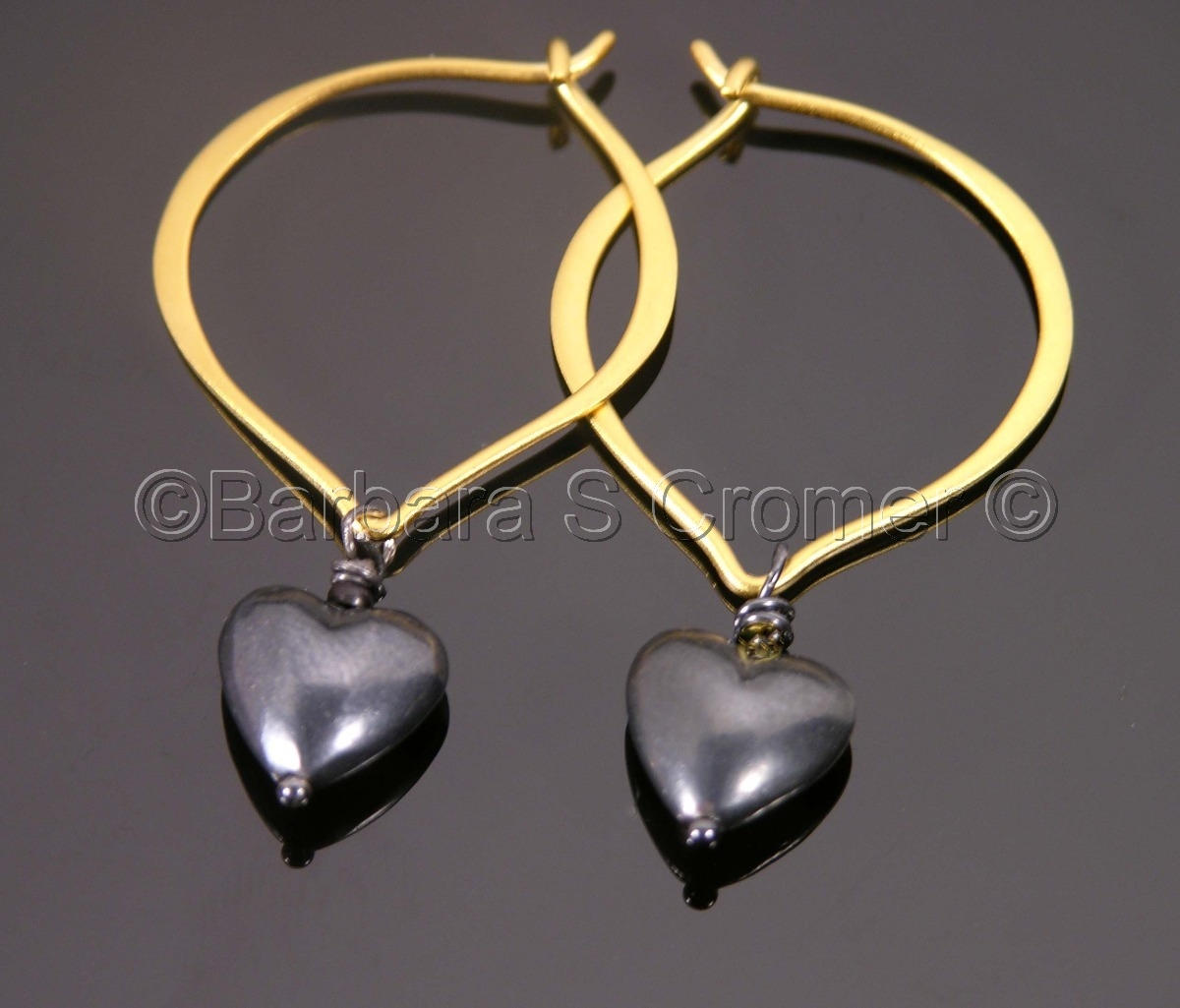 earrings of satin black finished Sterling silver Sophisticated hearts earrings Satin black finished hearts hanging gracefully from handmade Vermeil lotus ear wires, 2 inches (large view)