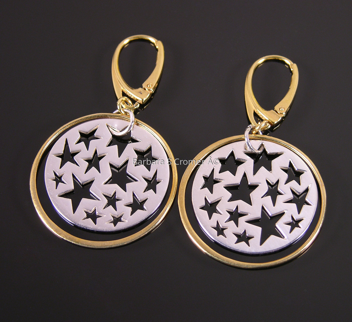 Golden ring around silver stars earrings (large view)
