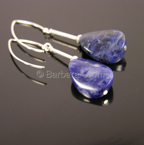 Polished Sodalite ovals on silver tubes