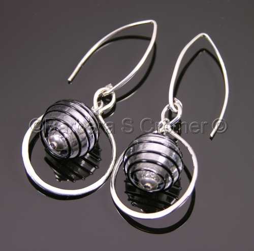 Ebony swirls on silver