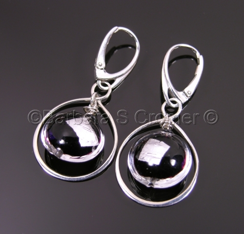 Black & silver Luna spheres encircled by silver