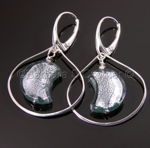 Silver encircles a silver half moon, earrings