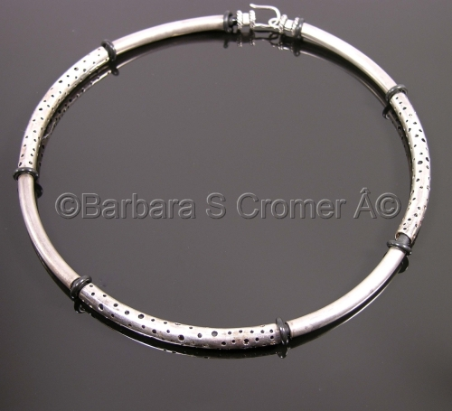 Modern Silver and neoprene neck ring