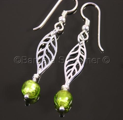 Silver leaves with peridot green bud, earrings