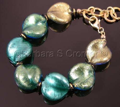 Venetian lamp work twists in shades of aqua and green bracelet
