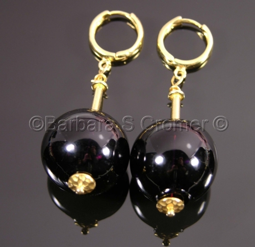 Black Venetian baubles on gold earrings