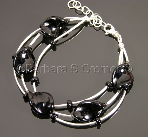 Triple strand of Black Venetian beads with Sterling silver bracelet