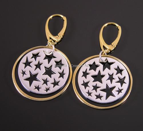 Golden ring around silver stars earrings