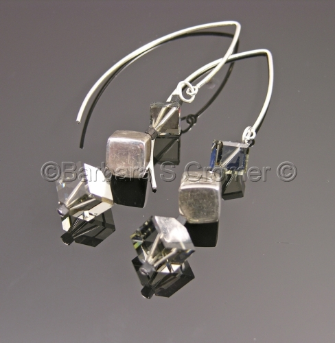 Silver and black diamond cubes on axis