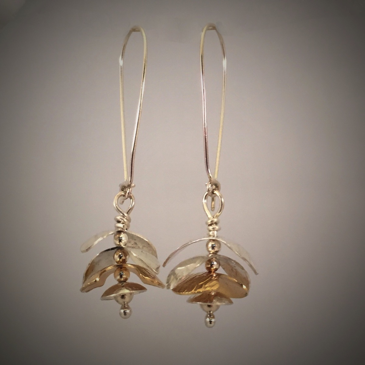 Kinetic Silver Bronze Whirligig Earrings  (large view)