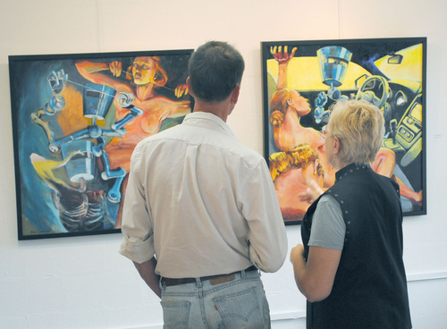Klaus Postler, Artist, and I discussing our take on the new gallery and how the paintings feel in the space.