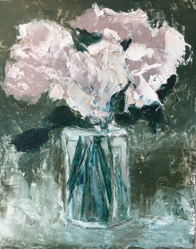 White flowers in clear vase