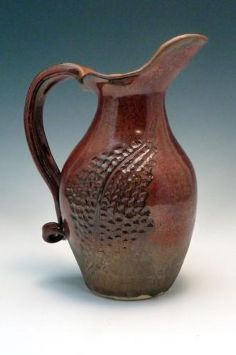 Brown vase with carving