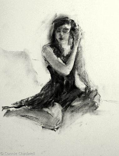 """Seated Figure in Black and White"""