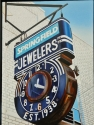 Old jeweler sign with an old cloc in Springfield, NJ depicted in an oil painting by artist Donald B. David. (thumbnail)