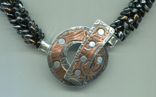 Silver and Copper Clasp with Black Dragon Tail