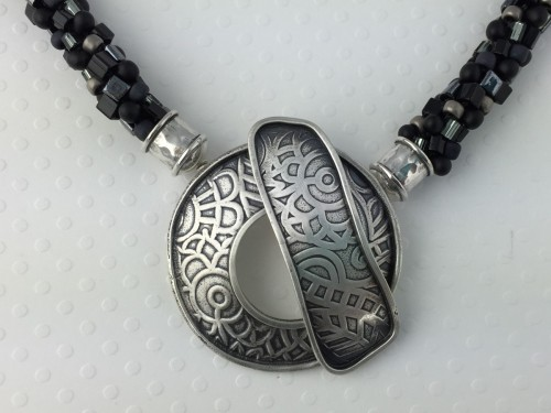 Silver Circle Clasp on Black Kumihimo Necklace