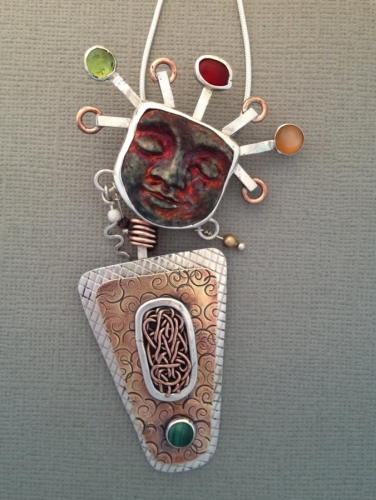 designs by roselyn, silver, clay face, semi-precious stones.
