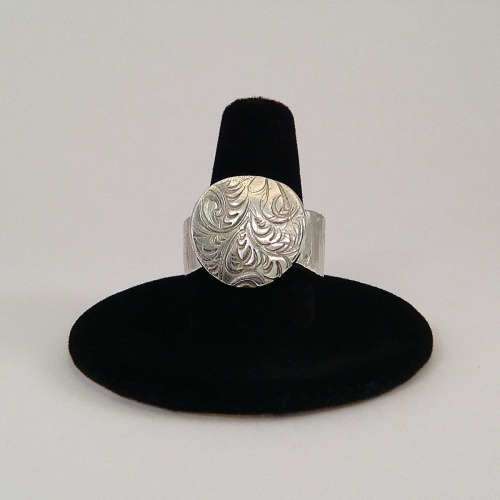 Curved embossed ring