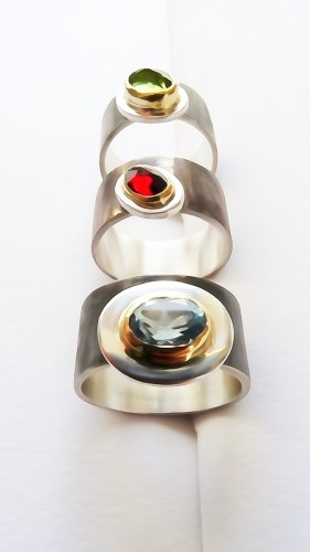 Stone set 18ct gold and oxodised rings.