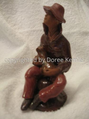 Ceramics-Seated Man Holding Dog