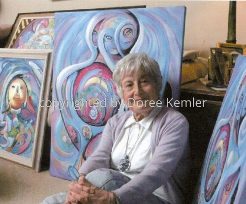 The artist surrounded by her art work (large view)