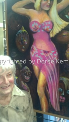 6 Doree exhibiting one of her paintings.