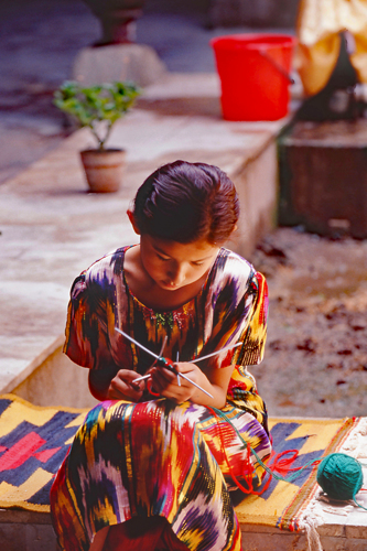 Little girl knitting