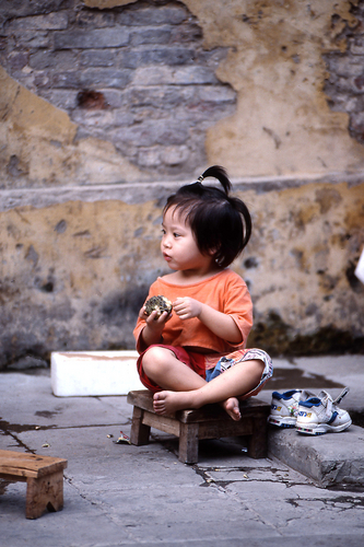 Little Girl Eating Fruit
