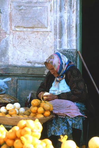 Old Woman Peeling Oranges