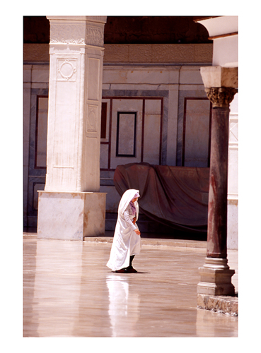 woman crossing mosque
