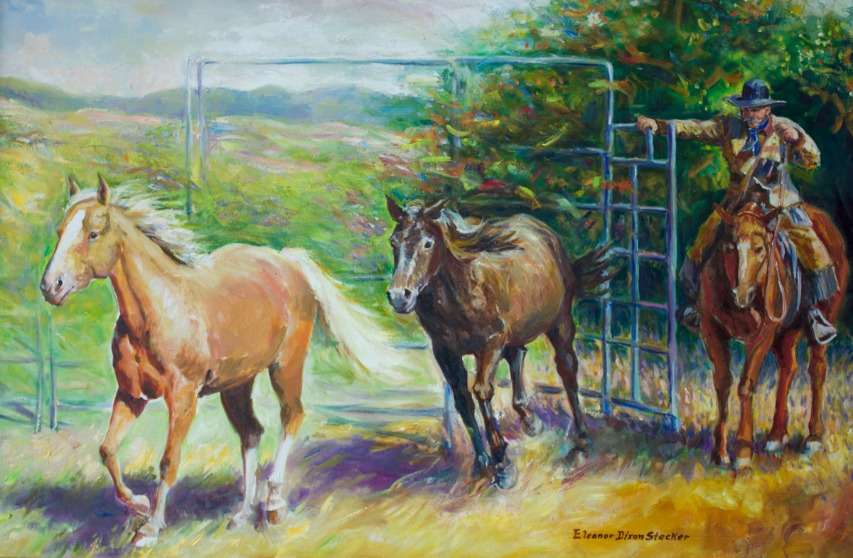 A cowboy opens the gate and allows two horses to run into pasture. (large view)