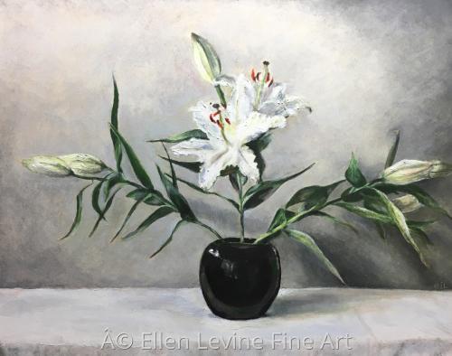 Lilies in black vase