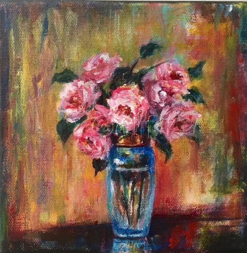 Pink roses in tall vase